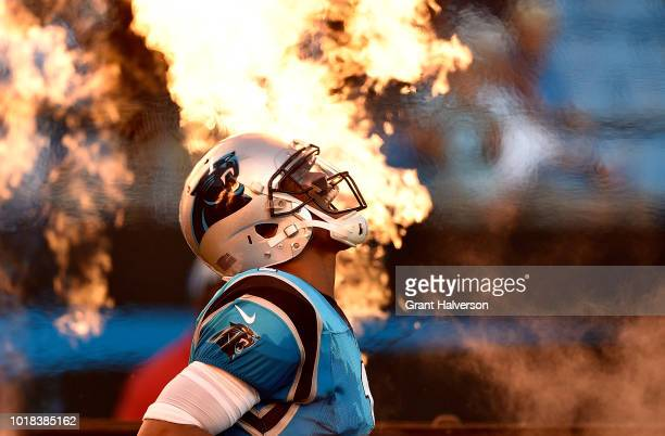 Cam Newton of the Carolina Panthers takes the field against the Miami Dolphins at Bank of America Stadium on August 17 2018 in Charlotte North...