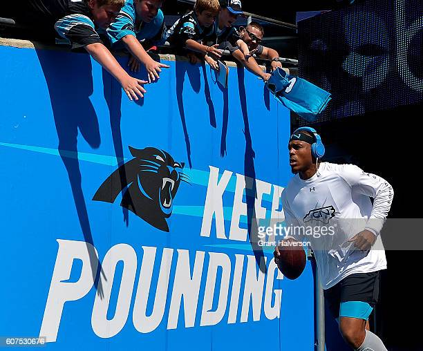 Cam Newton of the Carolina Panthers takes the field for warmups before the game against the San Francisco 49ers at Bank of America Stadium on...