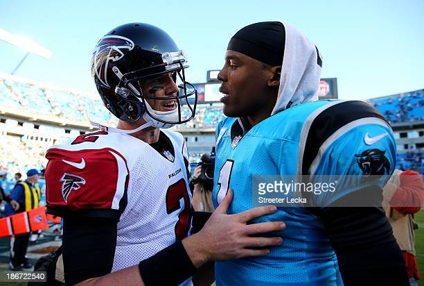 Cam Newton of the Carolina Panthers talks to Matt Ryan of the Atlanta Falcons after defeating the Falcons 3410 at Bank of America Stadium on November...