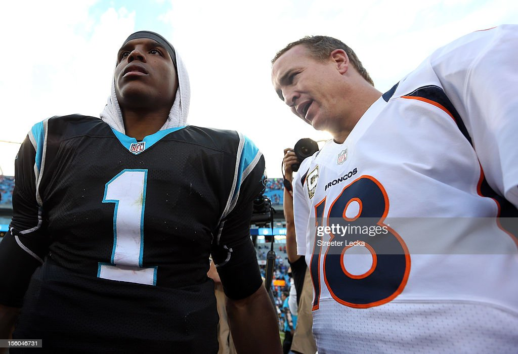 Cam Newton #1 of the Carolina Panthers talks to Peyton Manning #18 of the Denver Broncos after their game at Bank of America Stadium on November 11, 2012 in Charlotte, North Carolina.