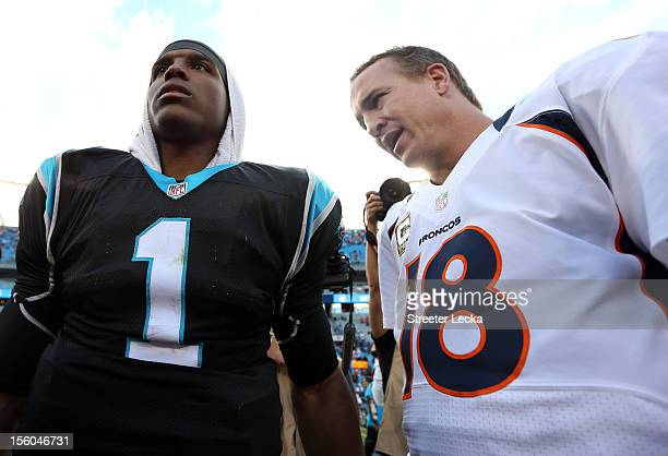 Cam Newton of the Carolina Panthers talks to Peyton Manning of the Denver Broncos after their game at Bank of America Stadium on November 11 2012 in...