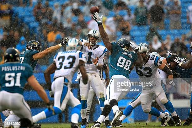 Cam Newton of the Carolina Panthers throws a pass against the Jacksonville Jaguars during their game at Bank of America Stadium on September 25 2011...