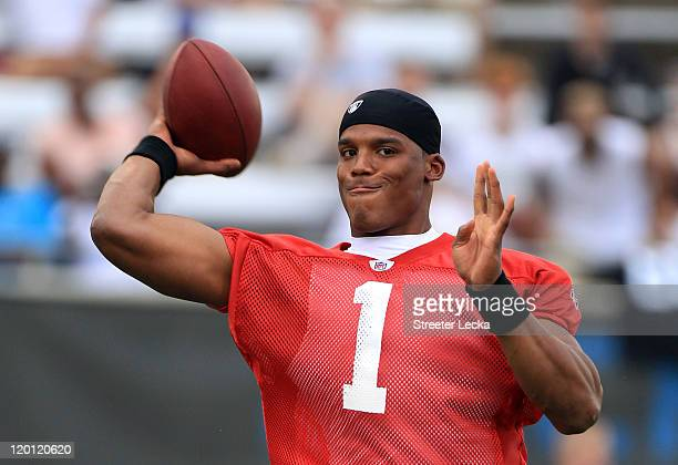 Cam Newton of the Carolina Panthers throws a pass during training camp at Wofford College on July 30, 2011 in Spartanburg, South Carolina.