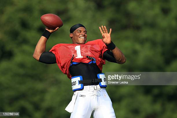 Cam Newton of the Carolina Panthers throws a pass during training camp at Wofford College on August 3, 2011 in Spartanburg, South Carolina.