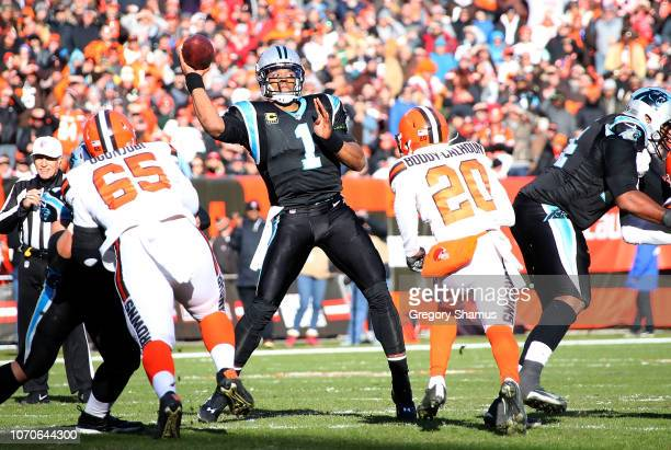 Cam Newton of the Carolina Panthers throws a pass in front of Briean BoddyCalhoun of the Cleveland Browns during the second quarter at FirstEnergy...