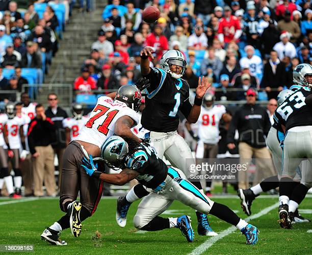Cam Newton of the Carolina Panthers throws a pass to set the NFL record for passing yards as a rookie during the game against the Tampa Bay...
