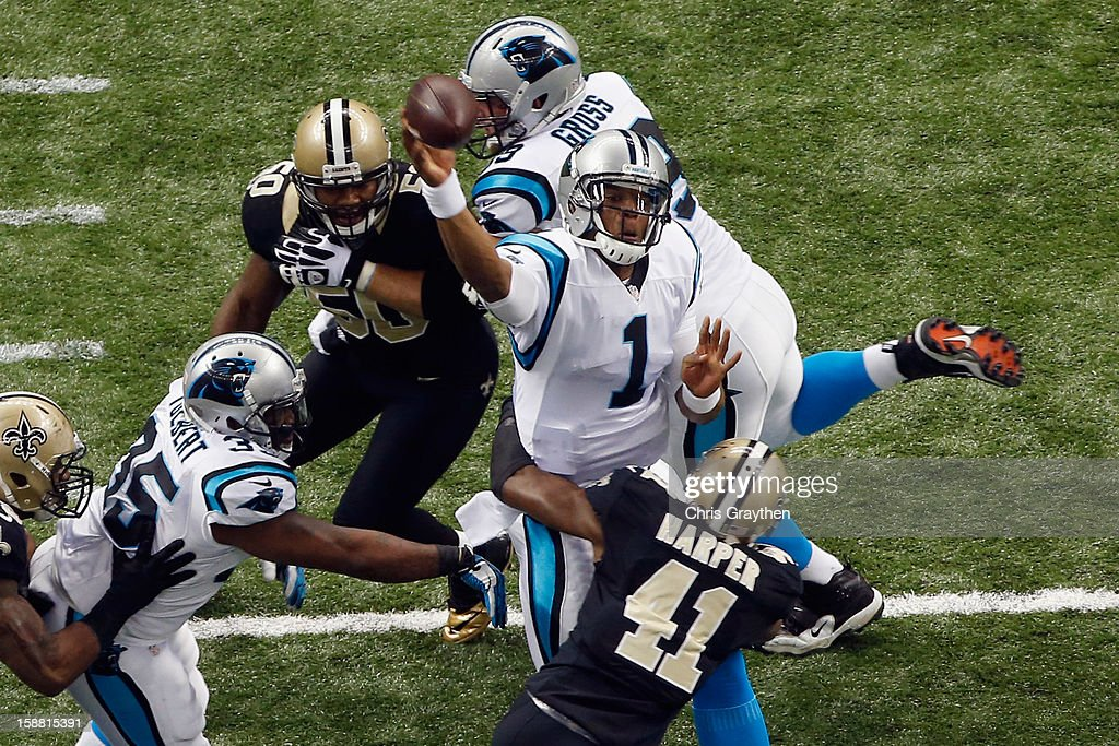 Cam Newton #1 of the Carolina Panthers throws the ball against the New Orleans Saints at the Mercedes-Benz Superdome on December 30, 2012 in New Orleans, Louisiana.