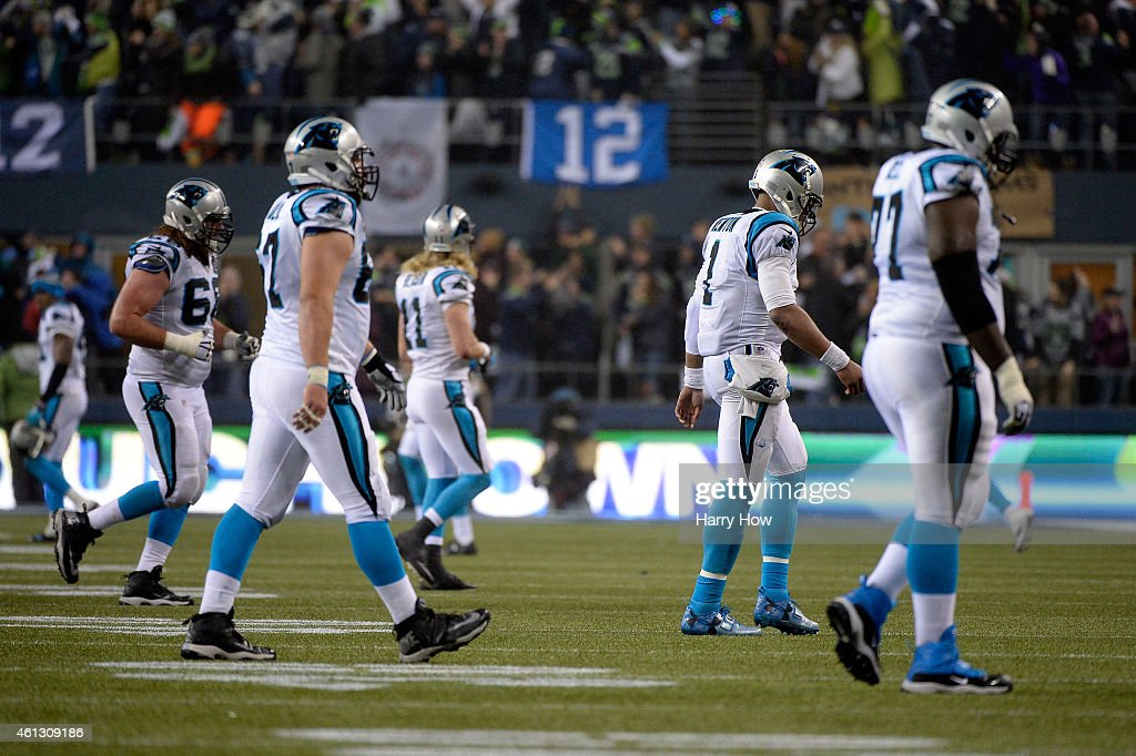 Cam Newton #1 of the Carolina Panthers walks off the field after throwing an interception to Kam Chancellor #31 of the Seattle Seahawks scoring a 90 yard touchdown in the fourth quarter during the 2015 NFC Divisional Playoff game at CenturyLink Field on January 10, 2015 in Seattle, Washington.