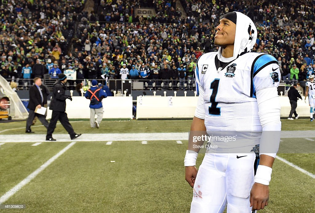 Cam Newton #1 of the Carolina Panthers walks off the field after being defeated by the Seattle Seahawks in the 2015 NFC Divisional Playoff game at CenturyLink Field on January 10, 2015 in Seattle, Washington. The Seattle Seahawks defeated the Carolina Panthers 31 to 17.