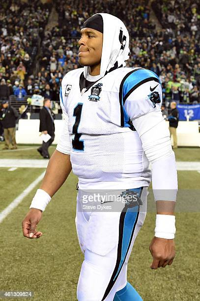 Cam Newton of the Carolina Panthers walks off the field after being defeated by the Seattle Seahawks in the 2015 NFC Divisional Playoff game at...