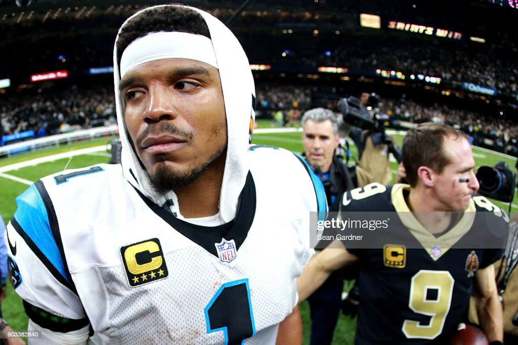 Cam Newton #1 of the Carolina Panthers walks off the field after his team was defeated by the New Orleans Saints during the second half of the NFC Wild Card playoff game at the Mercedes-Benz Superdome on January 7, 2018 in New Orleans, Louisiana.