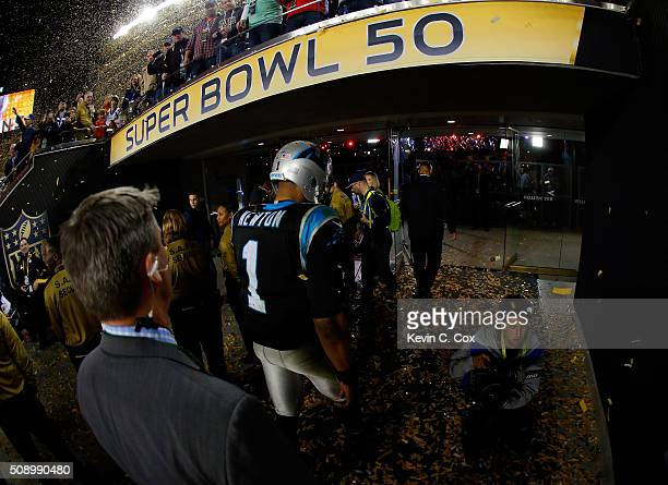 Cam Newton of the Carolina Panthers walks off the field following his loss to the Denver Broncos in Super Bowl 50 at Levi's Stadium on February 7...