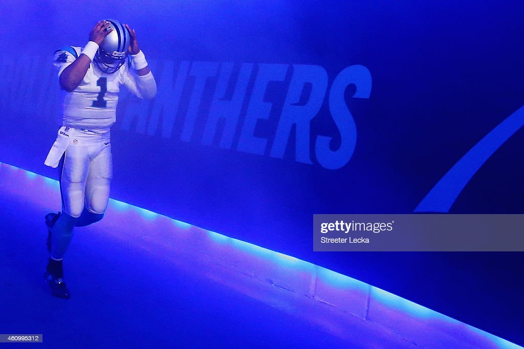 Cam Newton #1 of the Carolina Panthers walks through the tunnel towards the field prior to their NFC Wild Card Playoff game against the Arizona Cardinals at Bank of America Stadium on January 3, 2015 in Charlotte, North Carolina.