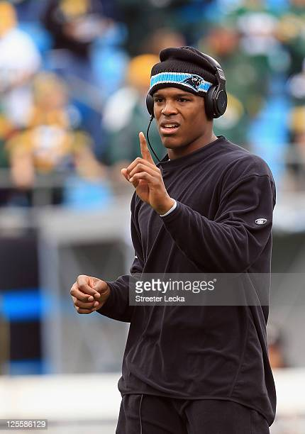 Cam Newton of the Carolina Panthers warms up before the game against the Green Bay Packers during their game at Bank of America Stadium on September...