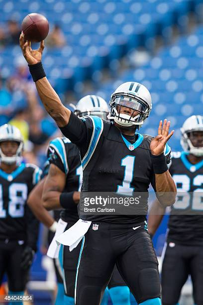 Cam Newton of the Carolina Panthers warms up before the game against the Buffalo Bills on August 14 2015 at Ralph Wilson Stadium in Orchard Park New...