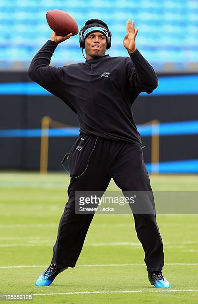 Cam Newton of the Carolina Panthers warms up before their game against the Green Bay Packers during their game at Bank of America Stadium on...