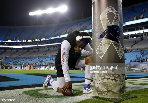 Cam Newton of the Carolina Panthers warms up before their game against the Miami Dolphins at Bank of America Stadium on November 13 2017 in Charlotte...