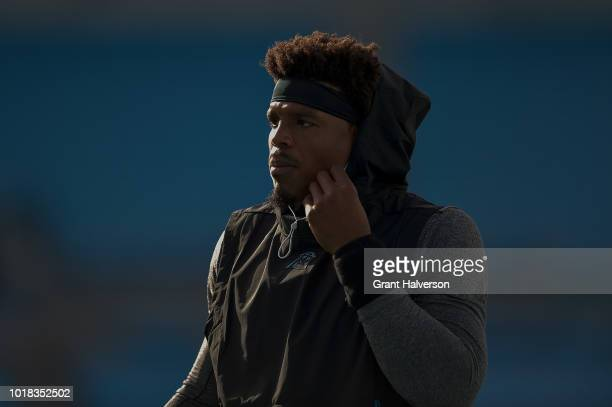 Cam Newton of the Carolina Panthers warms up before their preseason game against the Miami Dolphins at Bank of America Stadium on August 17 2018 in...