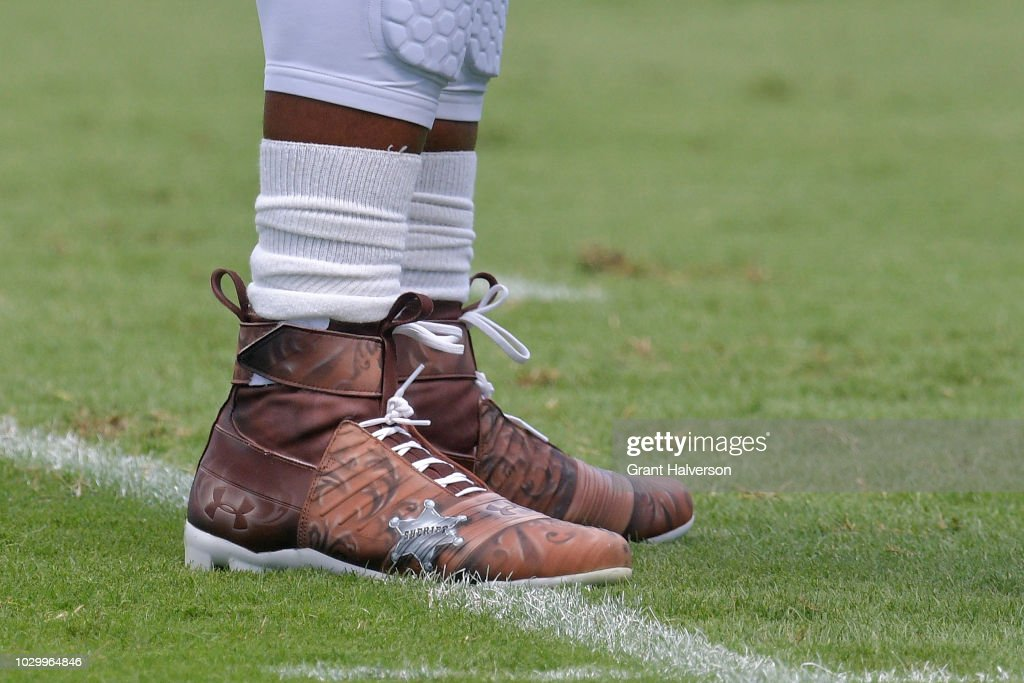 ce456c1d1f2d Cam Newton of the Carolina Panthers wears cowboy boot-themed cleats ...