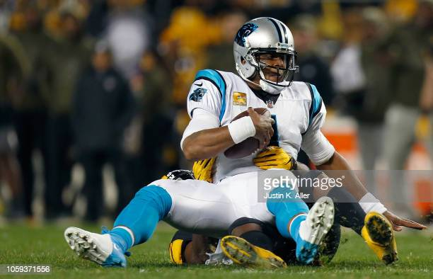 Cam Newton of the Carolina Panthers wrapped up for a sack by Vince Williams of the Pittsburgh Steelers during the first half in the game at Heinz...