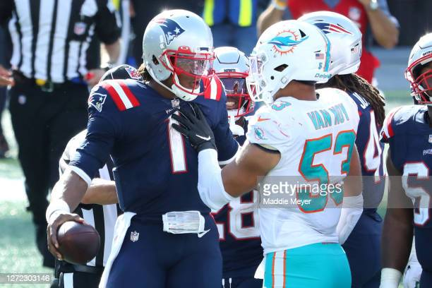 Cam Newton of the New England Patriots and Kyle Van Noy of the Miami Dolphins are involved in an altercation following their game at Gillette Stadium...
