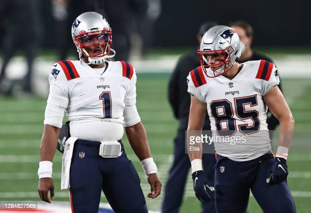 Cam Newton of the New England Patriots and Ryan Izzo look on during warmups before the game against the New York Jets at MetLife Stadium on November...