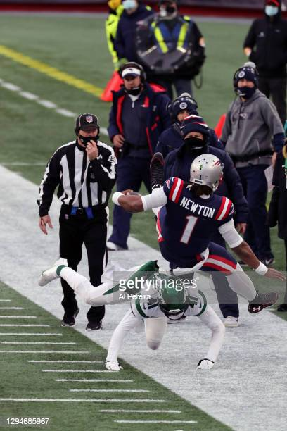Cam Newton of the New England Patriots gets knocked out of bounds against the New York Jets at Gillette Stadium on January 3, 2021 in Foxborough,...