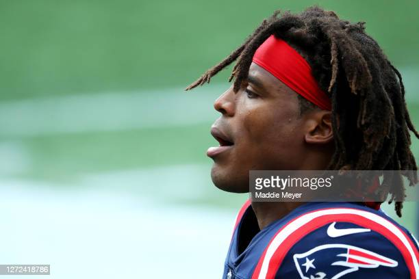 Cam Newton of the New England Patriots looks on during the game against the Miami Dolphins at Gillette Stadium on September 13 2020 in Foxborough...