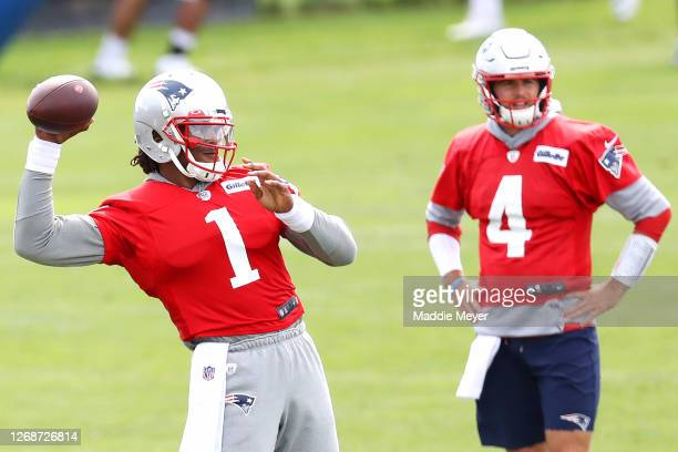 Cam Newton of the New England Patriots makes a throw as Jarrett Stidham looks on during Patriots Training camp at Gillette Stadium on August 26 2020...