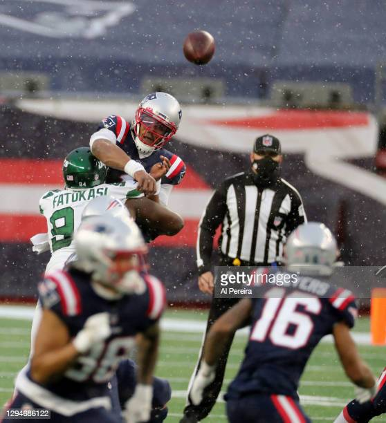 Cam Newton of the New England Patriots passes the ball against the New York Jets at Gillette Stadium on January 3, 2021 in Foxborough, Massachusetts.