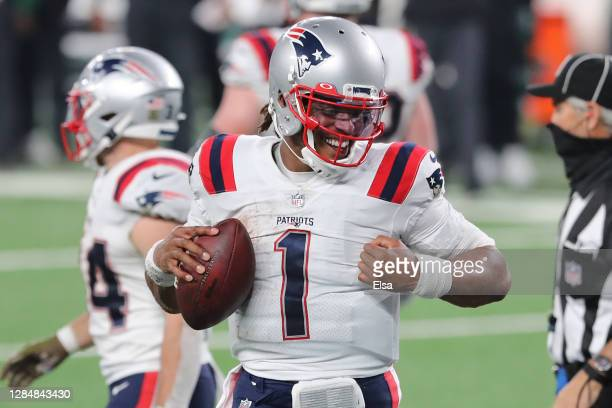 Cam Newton of the New England Patriots reacts after scoring a gametying touchdown during the second half against the New York Jets at MetLife Stadium...