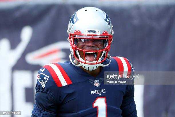 Cam Newton of the New England Patriots reacts before the game against the Miami Dolphins at Gillette Stadium on September 13 2020 in Foxborough...