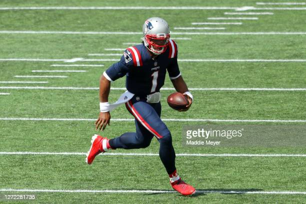 Cam Newton of the New England Patriots runs with the ball during the first half against the Miami Dolphins at Gillette Stadium on September 13 2020...
