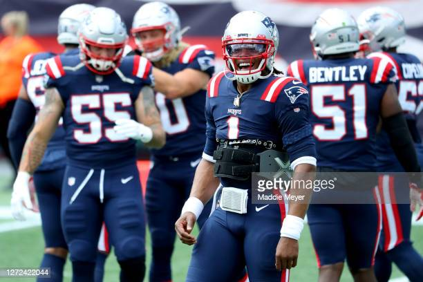 Cam Newton of the New England Patriots smiles during warm ups before the game against the Miami Dolphins at Gillette Stadium on September 13 2020 in...