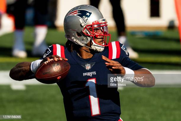 Cam Newton of the New England Patriots throws during the second half of a game against the Denver Broncos at Gillette Stadium on October 18 2020 in...
