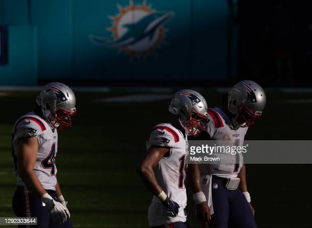 Cam Newton of the New England Patriots walks off the field against the Miami Dolphins during the fourth quarter in the game at Hard Rock Stadium on...