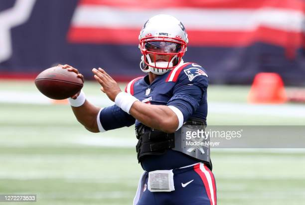 Cam Newton of the New England Patriots warms up before the game against the Miami Dolphins at Gillette Stadium on September 13 2020 in Foxborough...