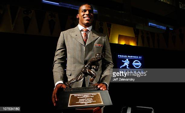 Cam Newton quarterback of the Auburn University Tigers poses with the 2010 Heisman Memorial Trophy Award on December 11 2010 in New York City