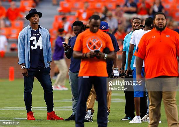 Cam Newton quarterback of the Carolina Panthers stands on the field during pregame warmups prior to the game between the Auburn Tigers and the...