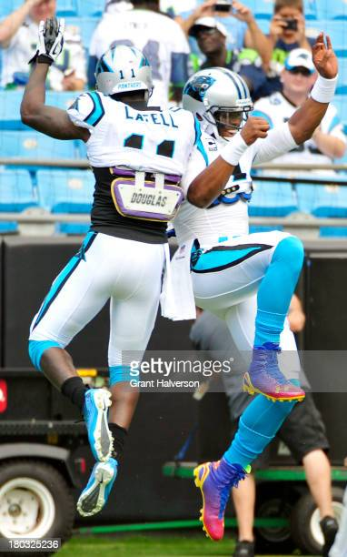Cam Newton wearing 'Superman' cleats and Brandon LaFell of the Carolina Panthers warm up before a game against the Seattle Seahawks at Bank of...
