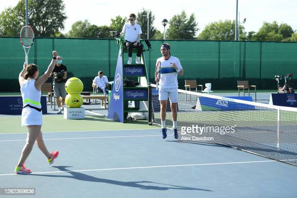 Cam Norrie and Beth Grey of British Bulldogs celebrate after their victory in their match with Jamie Murray and Katie Boulter after their victory...