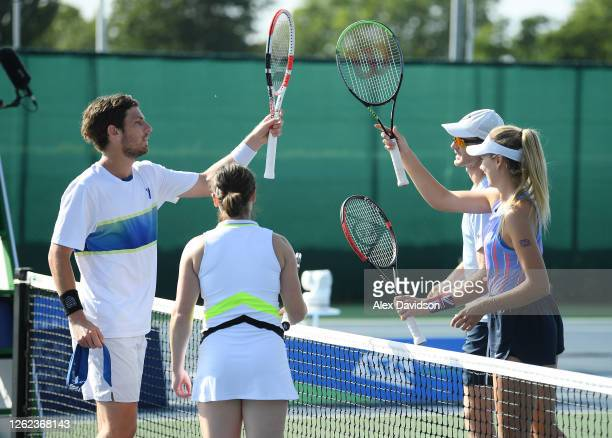Cam Norrie and Beth Grey of British Bulldogs interact interact with Jamie Murray and Katie Boulter after their victory during day three St. James's...