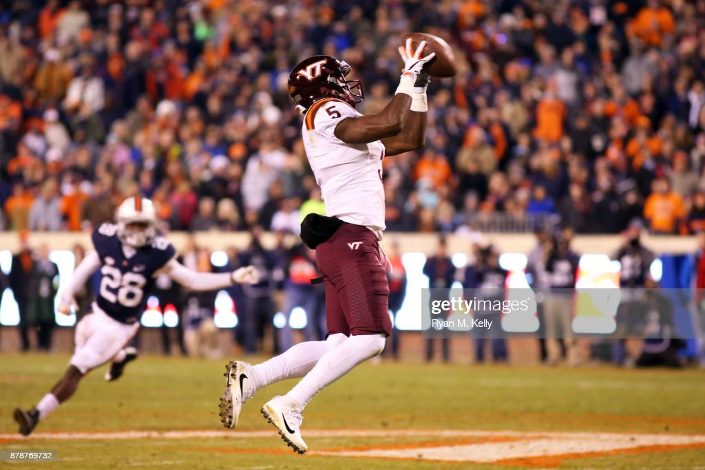 Cam Phillips #5 of the Virginia Tech Hokies catches a pass in the third quarter during a game against the Virginia Cavaliers at Scott Stadium on November 24, 2017 in Charlottesville, Virginia. Virginia Tech defeated Virginia 10-0.