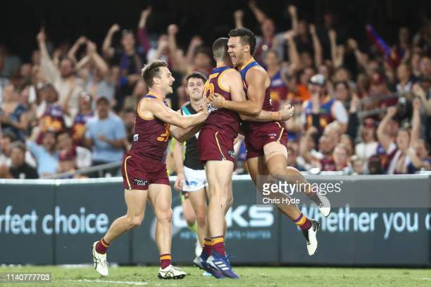 Cam Rayner of the Lions celebrates a goal during the round three AFL match between the Brisbane Lions and the Port Adelaide Power at The Gabba on...