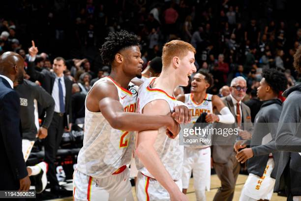 Cam Reddish, and Kevin Huerter of the Atlanta Hawks react after the game against the San Antonio Spurs on January 17, 2020 at the AT&T Center in San...