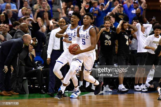 Cam Reddish and RJ Barrett of the Duke Blue Devils celebrate following their 7776 win against the Central Florida Knights during the second round of...