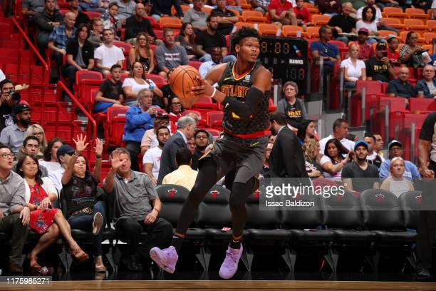 Cam Reddish of the Atlanta Hawks handles the ball against the Miami Heat during a preseason game on October 14 2019 at American Airlines Arena in...