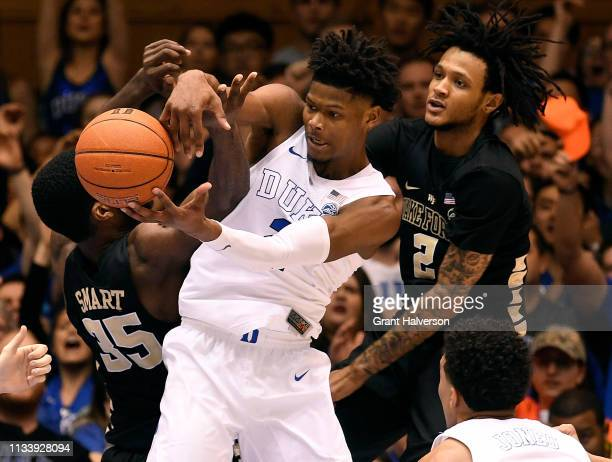 Cam Reddish of the Duke Blue Devils battles Ikenna Smart and Sharone Wright Jr #2 of the Wake Forest Demon Deacons for a rebound during the second...