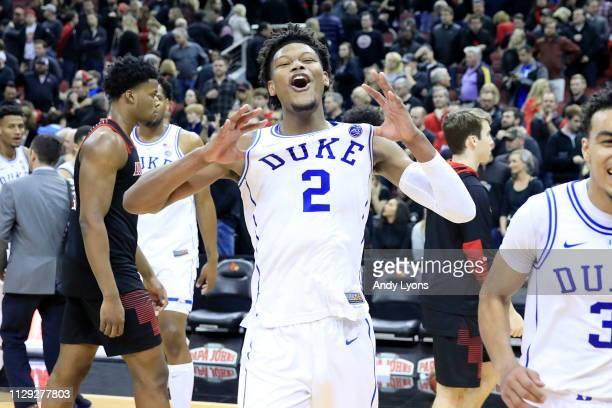 Cam Reddish of the Duke Blue Devils celebrates after the 71-69 win over the Louisville Cardinals at KFC YUM! Center on February 12, 2019 in...