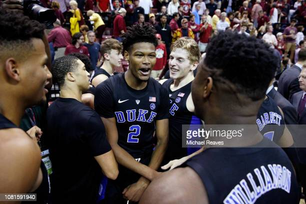 Cam Reddish of the Duke Blue Devils celebrates with teammates after defeating the Florida State Seminoles 80-78 at Donald L. Tucker Center on January...